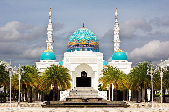 The Masjid Albukhary with its soaring minarets, blue domes and geometric patterns on its wide open spaced grounds