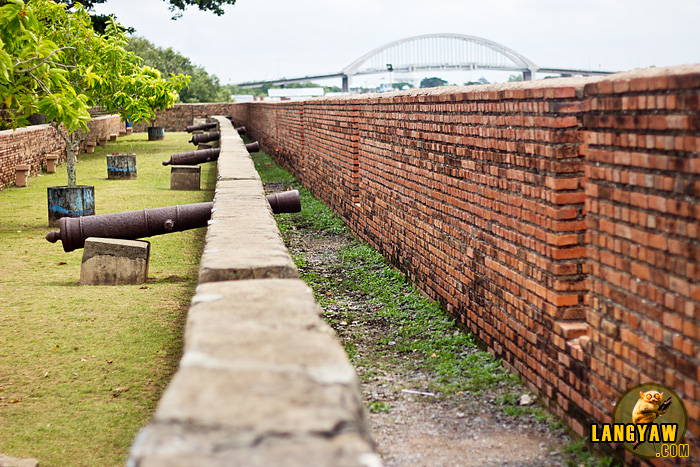 Canons ready to fire! Brick walls along the riverbanks with metal canons positioned as what may have been set up before
