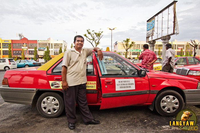 A taxi driver in Alor Setar waits for arriving passengers at the bus station
