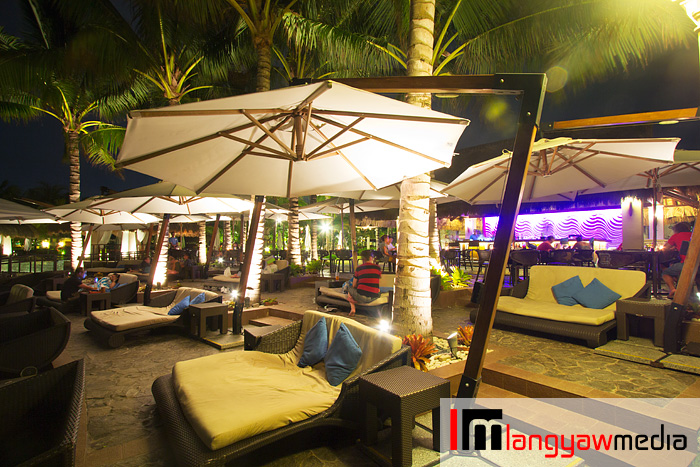 Enjoy the cool breeze while lounging or having drinks from Azure Pool Bar