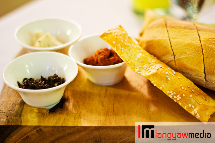 Ciabatta bread and lavoush (long bread stick) with different spreads: sun dried tomato, black olive tapenade and chicken coriander spread