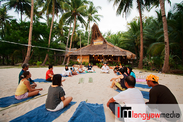 Weekly afternoon yoga at the front of the beach house for visitors and staff