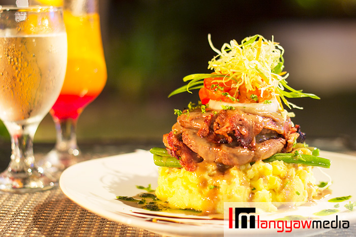 Island style fillet mignon: fillet mignon wrapped with bacon on a bed of mashed potatoes