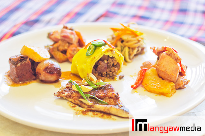 Plateful of other featured dishes: center, pork sisig egg roll; clockwise lower middle: fried bangus belly ala pobre sauce, beef brisket asado, pakbet sa cerveza, pansit buko and chicken afritada
