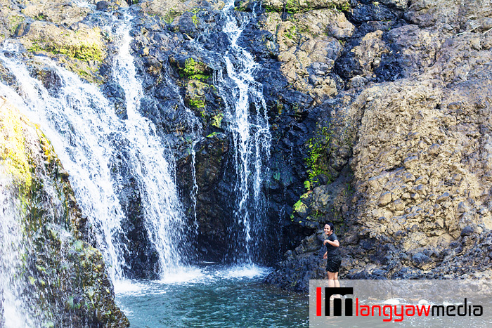 A military recruit enjoying a dip at the falls