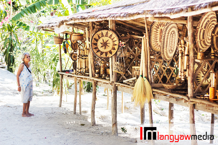Separate stalls also sell different types of woven wares from brooms to wrist bands to baskets