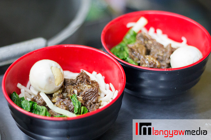 Beef noodle soup with hand pulled noodles and marbled eggs