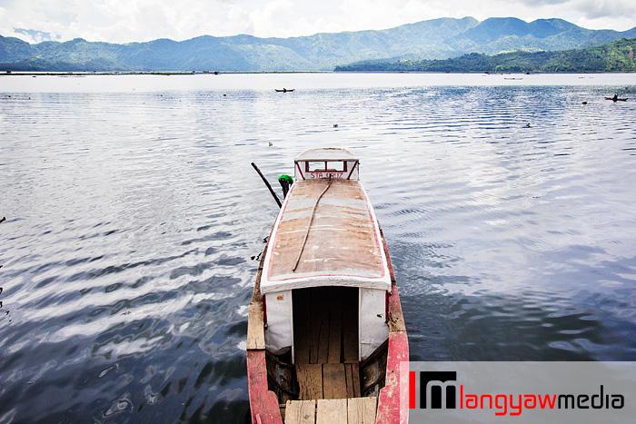 A small passenger vessel that plies Lake Buhi stops at the poblacion.