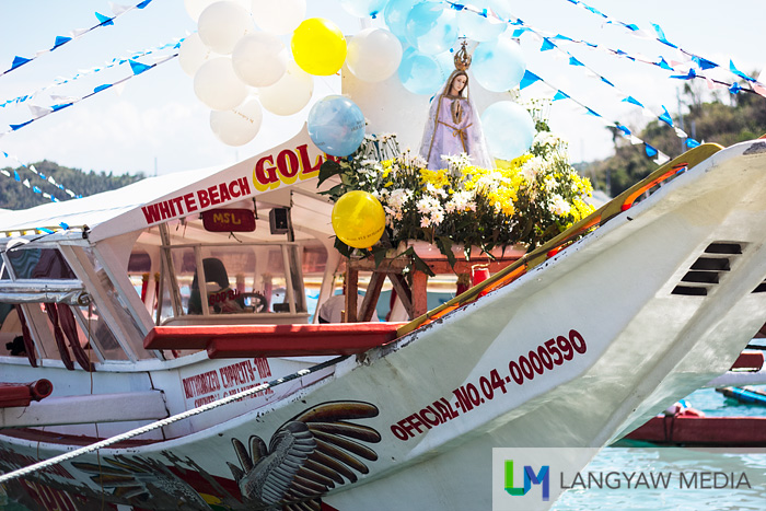 The image of the Our Lady of Fatima leads the fluvial procession along Puerto Galera Bay