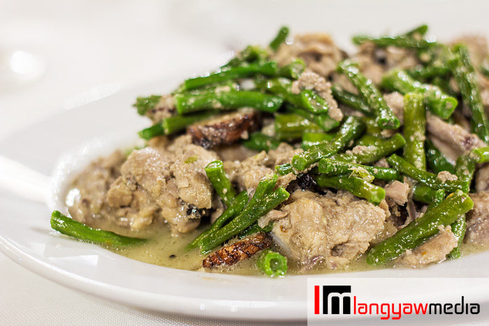 Pork with string beans and cooked in coconut milk