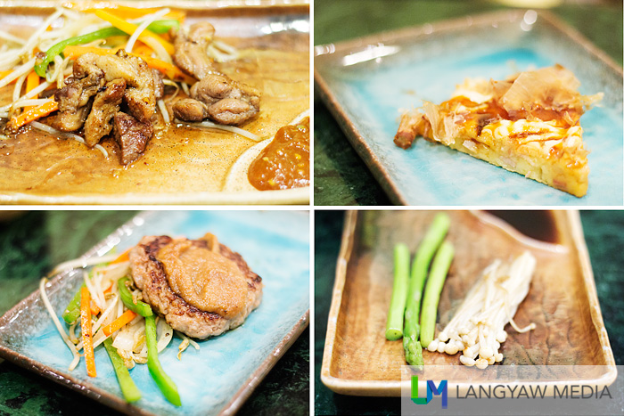 Clockwise from top right: Okonomiyaki, Japanese pancake with seafood and bacon, green asparagus and enoki with butter sauce, Hambago steak US ground beef with vegetables in onion sauce, and Aigamo rose imported duck and vegetables with garlic sauce