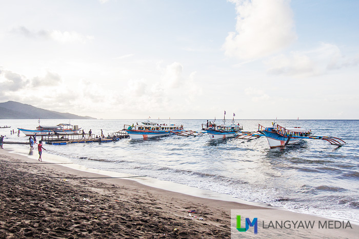 Early in the morning, motorized outrigger boats are lined up at Sabang to take passenger to Caramoan