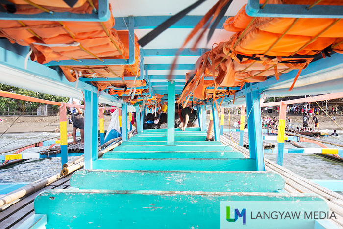 Inside the big wooden outrigger boats that plies the Sabang (San Jose) - Caramoan and vice versa route