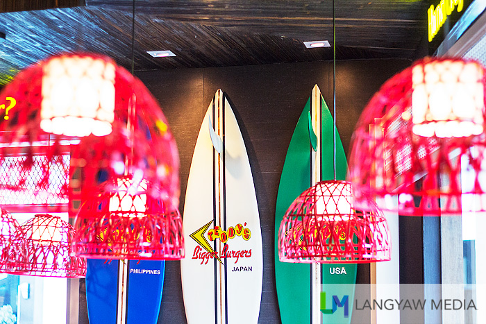 Nice decor including surf boards with the names of the three countries Teddy's Bigger Burgers are setting shop