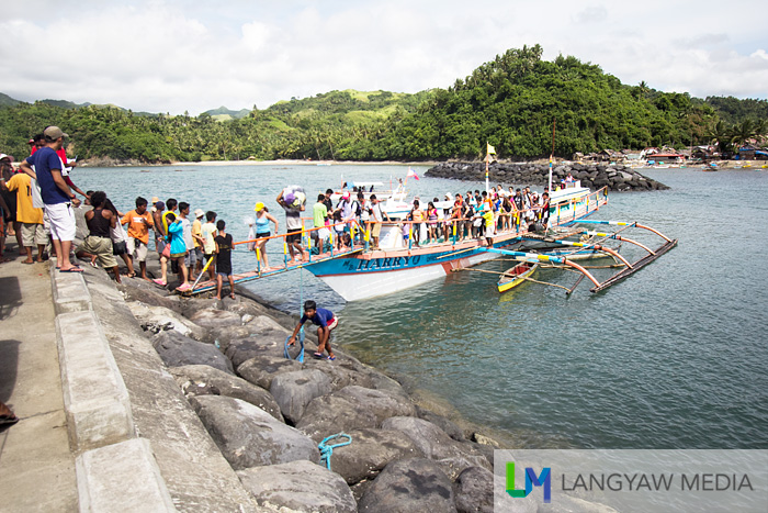 Visitors arriving at the Caramoan wharf aboard motorized outrigger boats