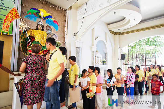 Devotees line up to venerate the image