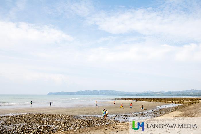Boys playing at Sindangan's historic beach