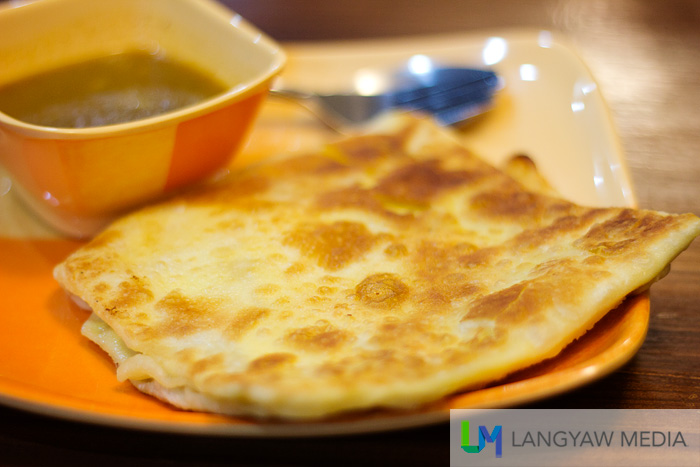 Roti tulul is roti filled with scrambled egg. It has a curry sauce as dip as well.