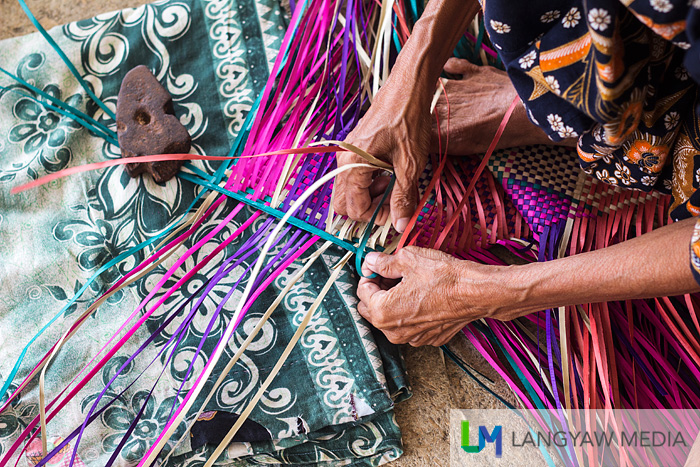 A tepo weaver committing to her design