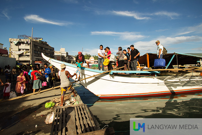 Despite everything, life just goes on. Passengers from another off sea barangay arrives in Tacloban