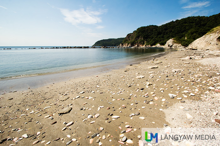 View of Resort Beach strewn with smooth round stones