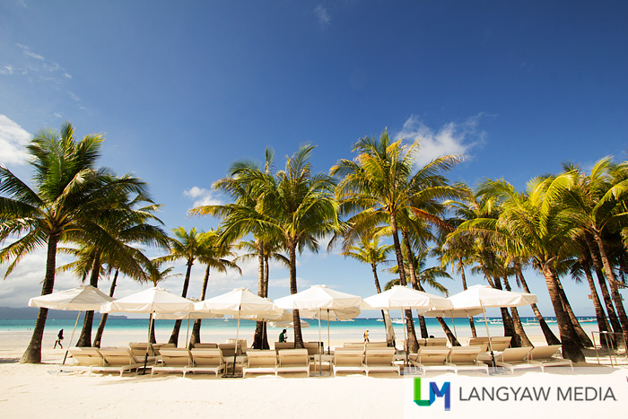 Beach umbrellas and lounging chairs for those who want to spend time at the beach