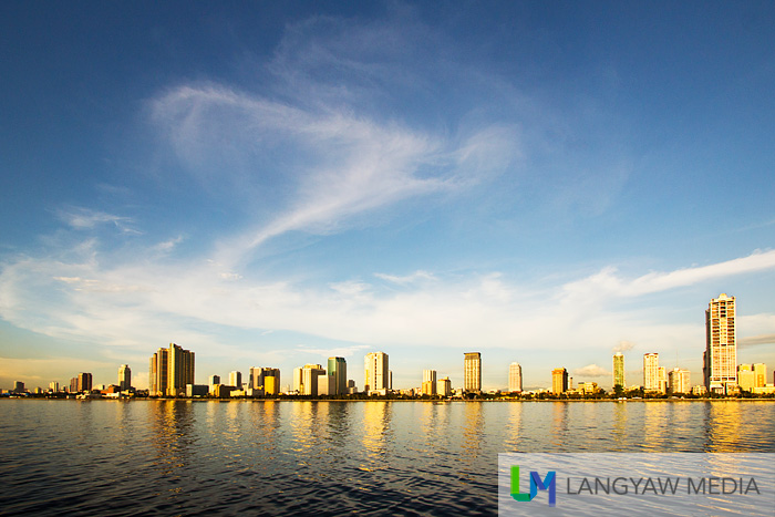 Stunning! Roxas Boulevard strip's buildings, blue sky and sea