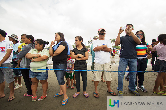 Cordoned off, onlookers at the regatta
