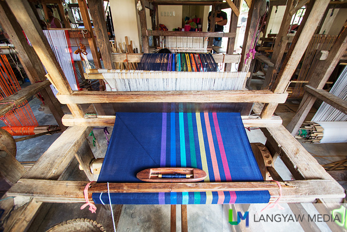 Colorful cloth being woven