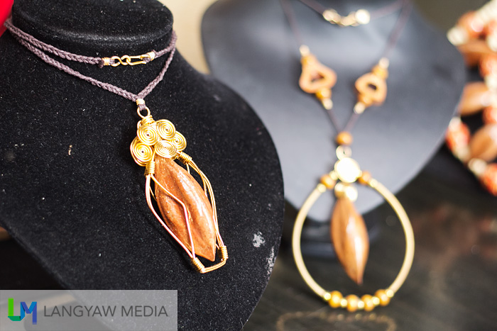 Stylized necklaces made from pili shells, wires and such