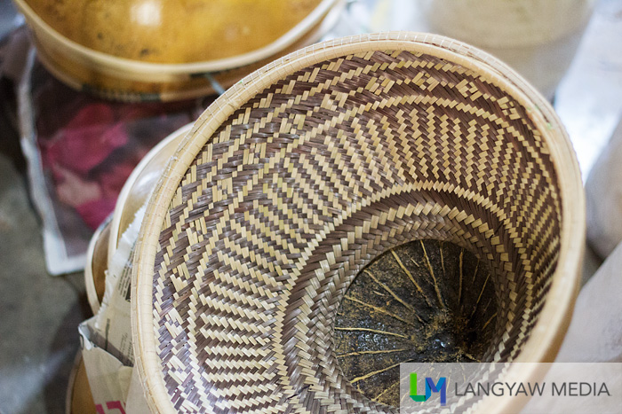 The intricate details of the woven interior of the 'tabungaw'