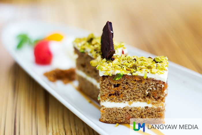 Caramel carrot cake  with pistachio and fruit balls of papaya and watermelon