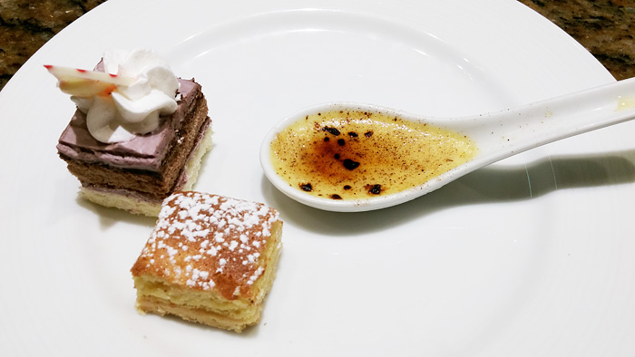 A slicee of ube and chocolate cake, tarta de santiago and cream catalana