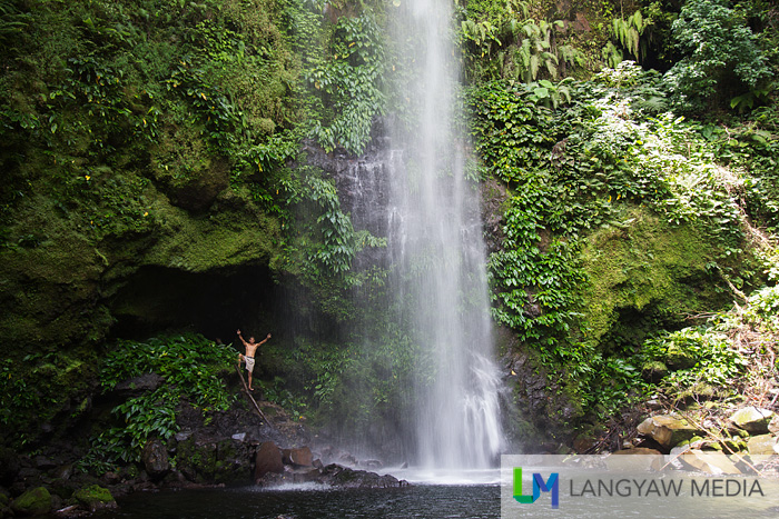 A small cavity near the pool of Balang Falls. Our tall and hunky guide gives scale to the size of the waterfalls
