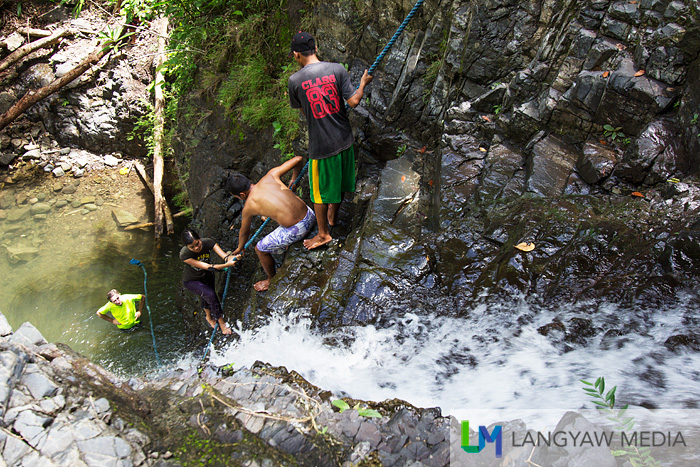 climbing up to the third level can be challenging as the rock is slippery while dealing with falling water. Although there's a strong thick rope to hold on too, my companion gave up because she had difficulty climbing up