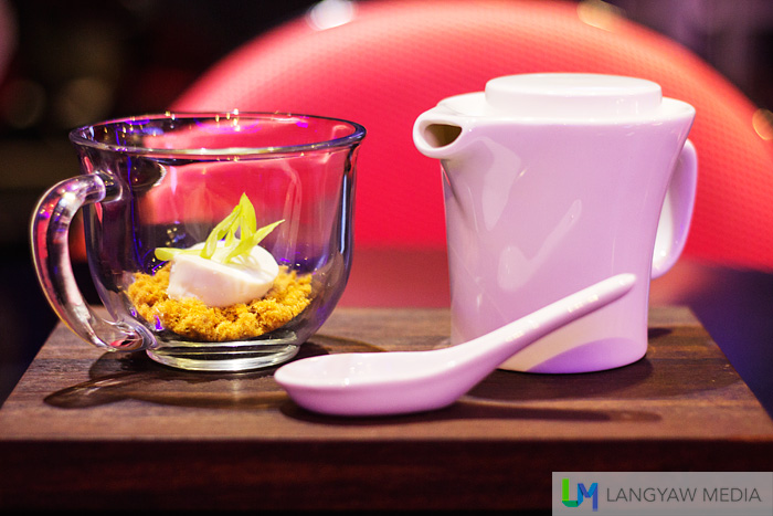Deconstructed miso soup bowl with a bed of pork floss topped with tofu and scallions