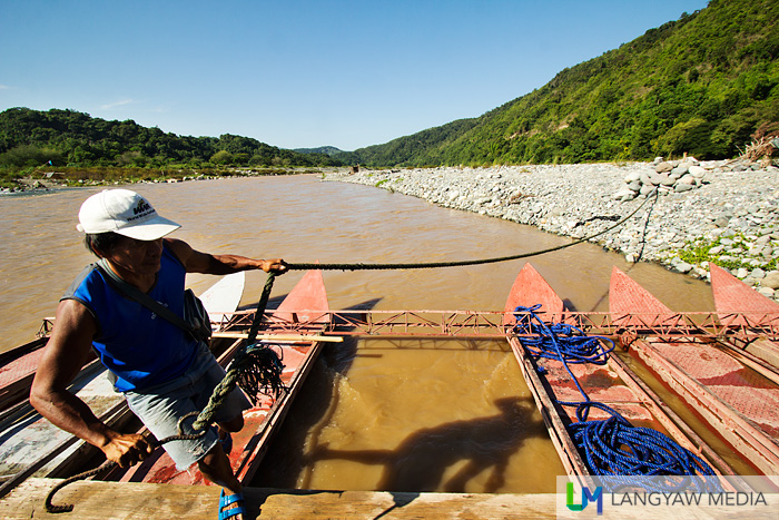 Metal raft that ferries vehicles and people across the Luba River