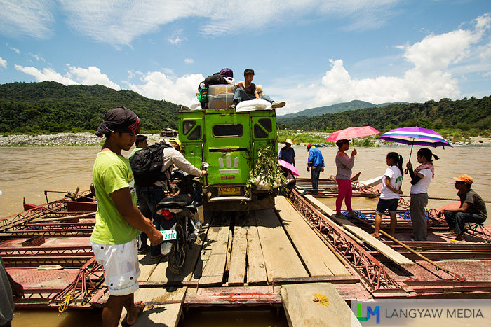 Preparing for the crossing with a jeepney and passengers