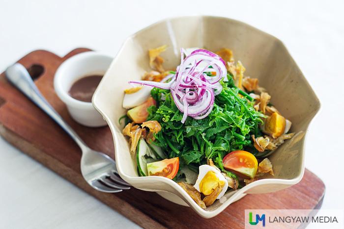 Pako salad with salted eggs and bagoong vainigrette