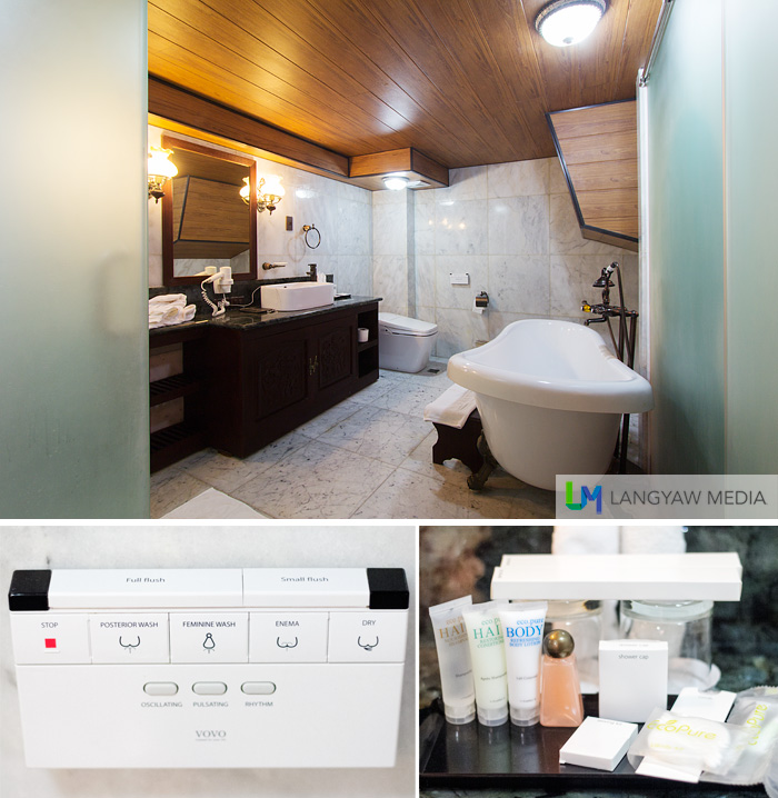 The spacious toilet and bath that includes a gorgeous tub and an ultramodern toilet. Below left, controls for the toilet; right, bath amenities.
