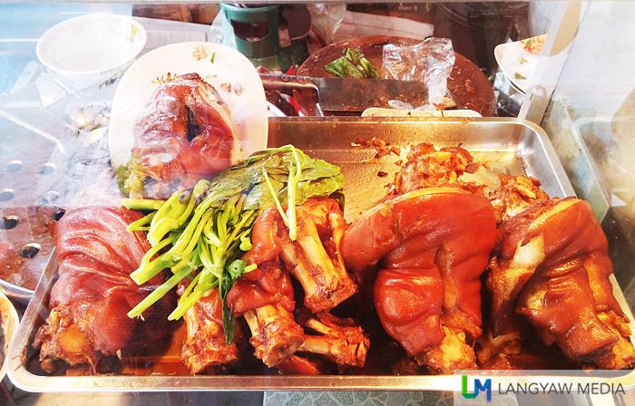 Stewed pork leg piled on top at this vendor's display