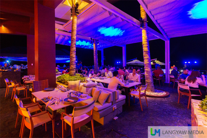 At night, Azure Beach Club transforms to a cool bar