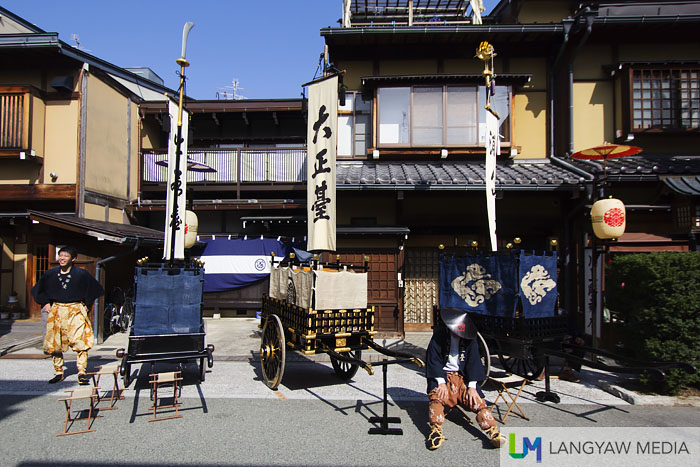 A member of the yatai-gumi group takes a rest before the yatai procession