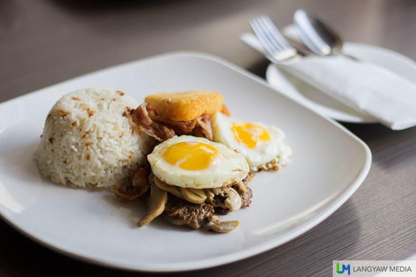 Garlic rice, beef medallion with sauteed mushrooms, two sunny side up eggs, hash brown and bacon