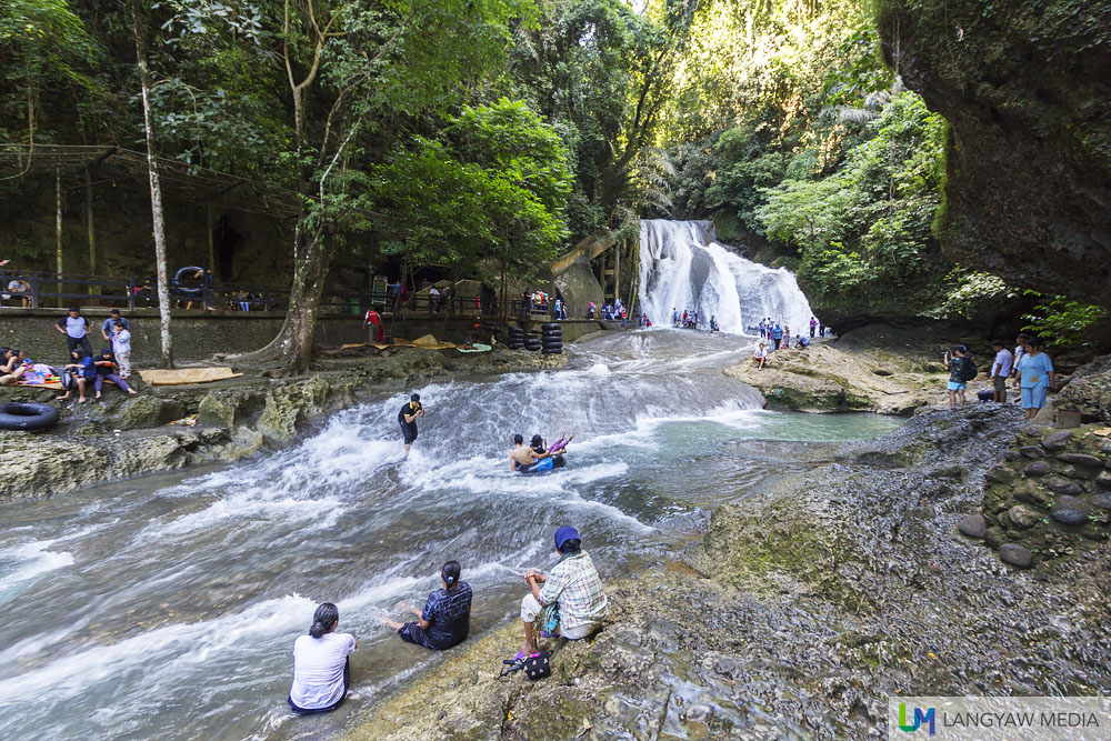 View of Bantimurung Waterfall and river. The banks are popular picnic areas for visitors