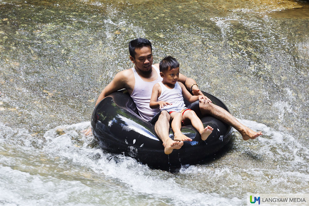 A fun way to enjoy Bantimurung Waterfalls is riding the water through this inflated tire tube