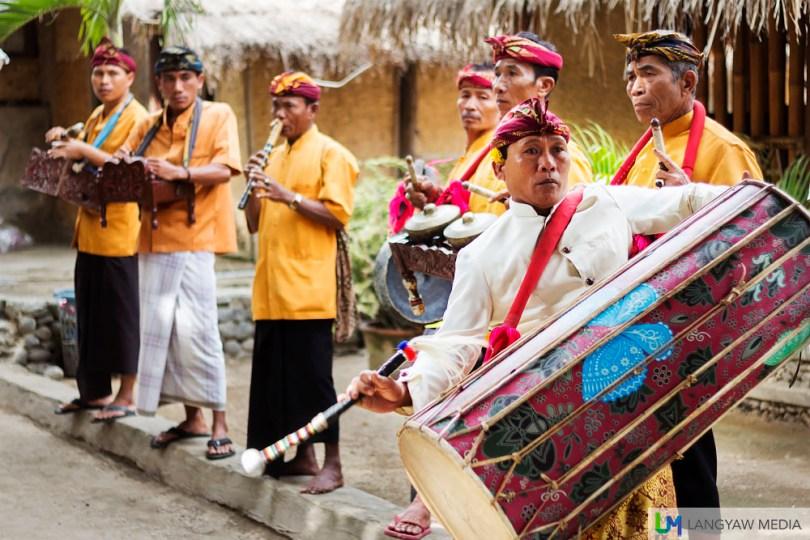 A traditional musical ensemble greets visitors to the Sasak Sade Village in Rembitan