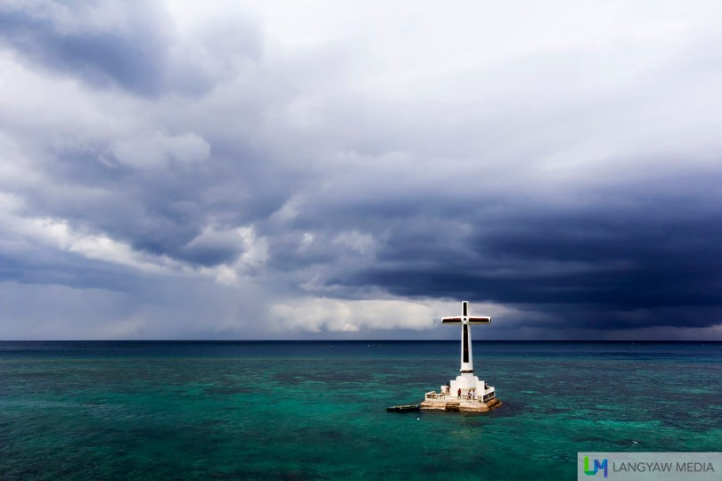 Beneath the emerald green sea is the sunken cemetery of Catarman which was buried when Vulcan Daan erupted.