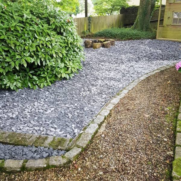 slate chippings in garden - st