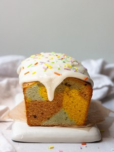 front view sliced and glazed rainbow pound cake